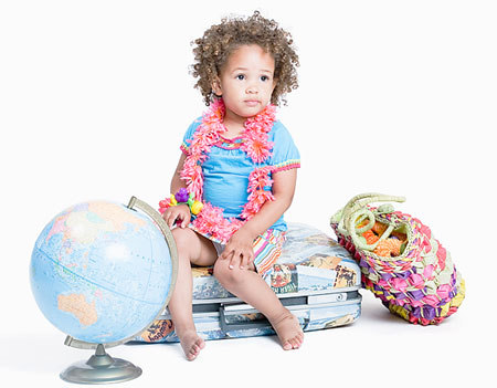 Traveling with Young Kids - Toddler Sitting on Luggage with a Globe