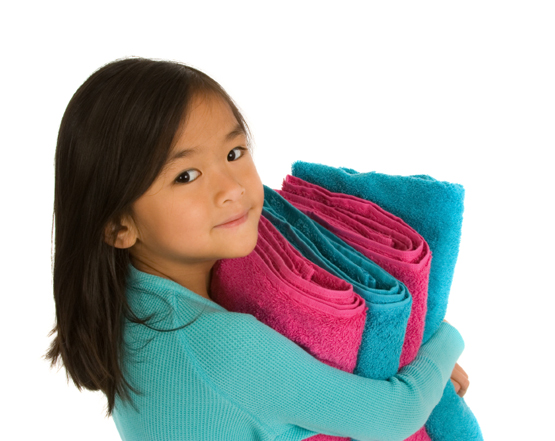 Chores for Kids - Girl holding folded towels