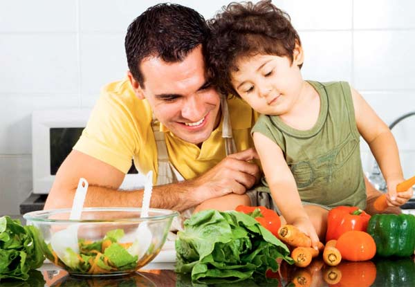 Dad and son eating vegetables - being a good role model