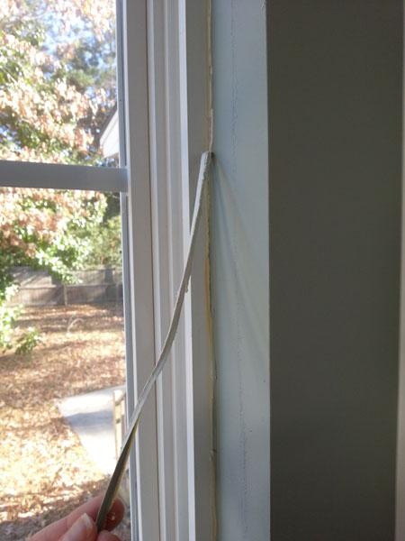 Weatherizing Windows - Peeling old caulking