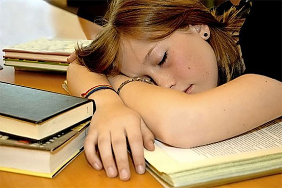 Teen Girl Sleeping on Books - North Texas Kids Magazine